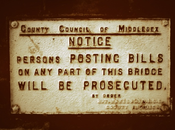 Middlesex says no to bill posting [Bridge over River Crane, London Rd]